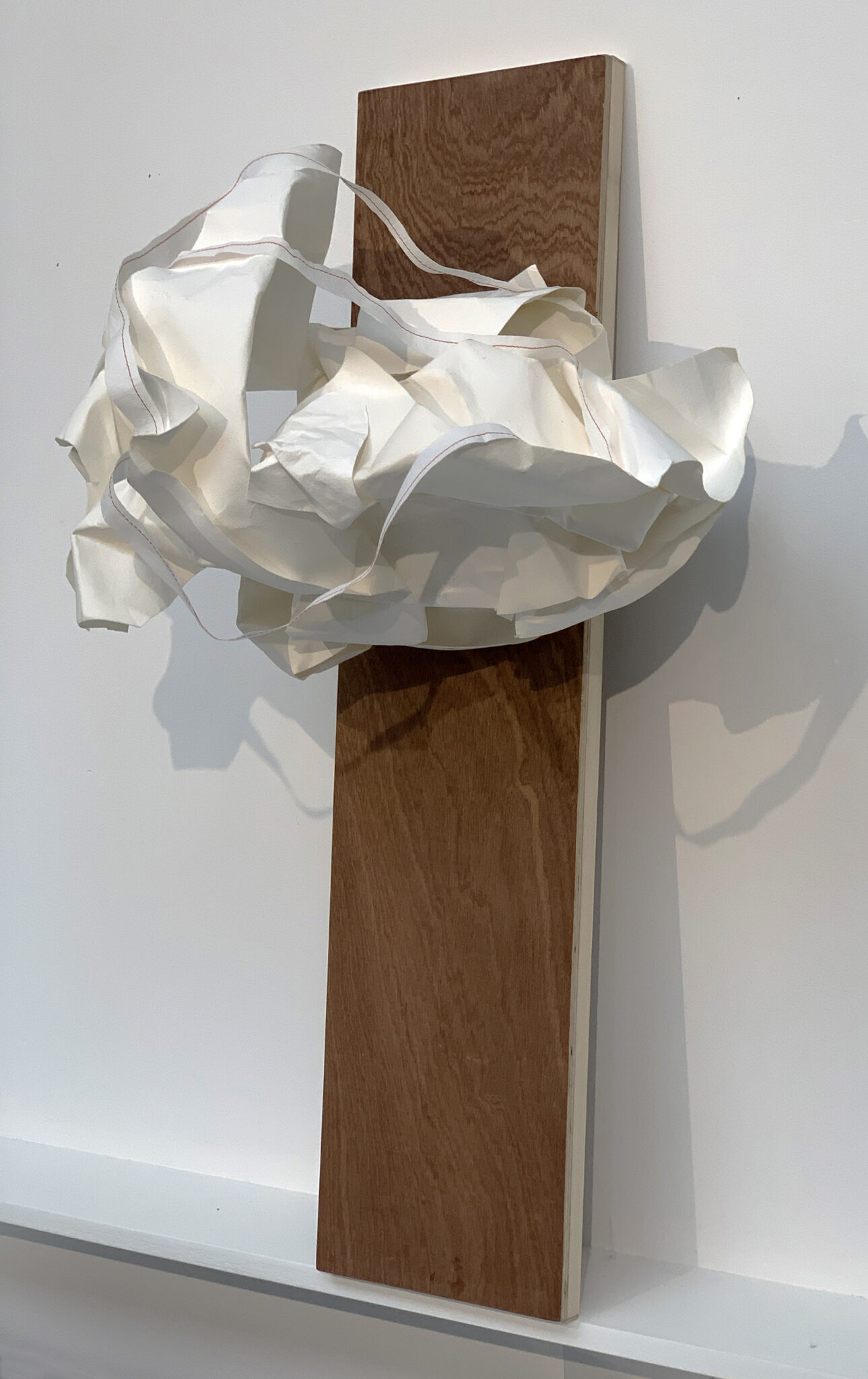 142<>She is in it<>Paper sculpture<>27x40x27 cm on wooden panel  20x83x2,7 cm