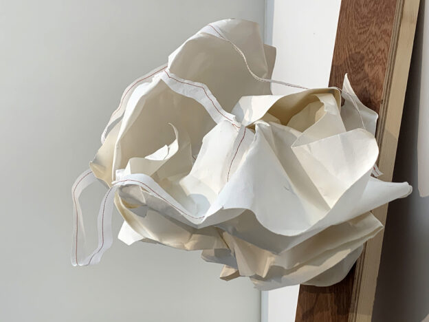 142She is in it 2  Paper sculpture27x40x27 cm on wooden panel  20x83x2,7 cm